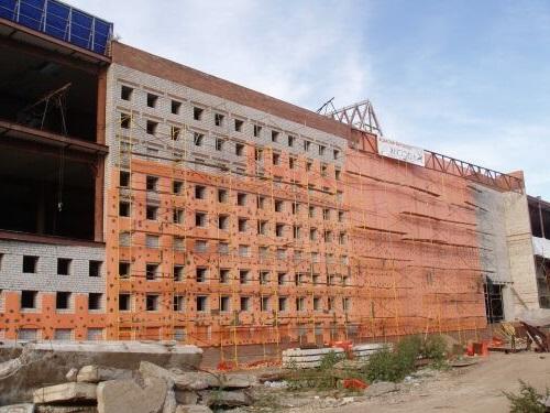 Теплоизоляция фасада многоквартирного дома Пеноплексом