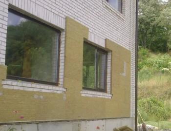 Утепление фасада минеральными плитами, на клей