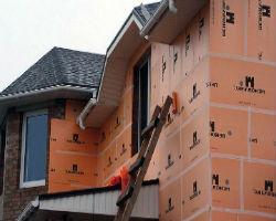Процесс утепления фасада дома пеноплексом